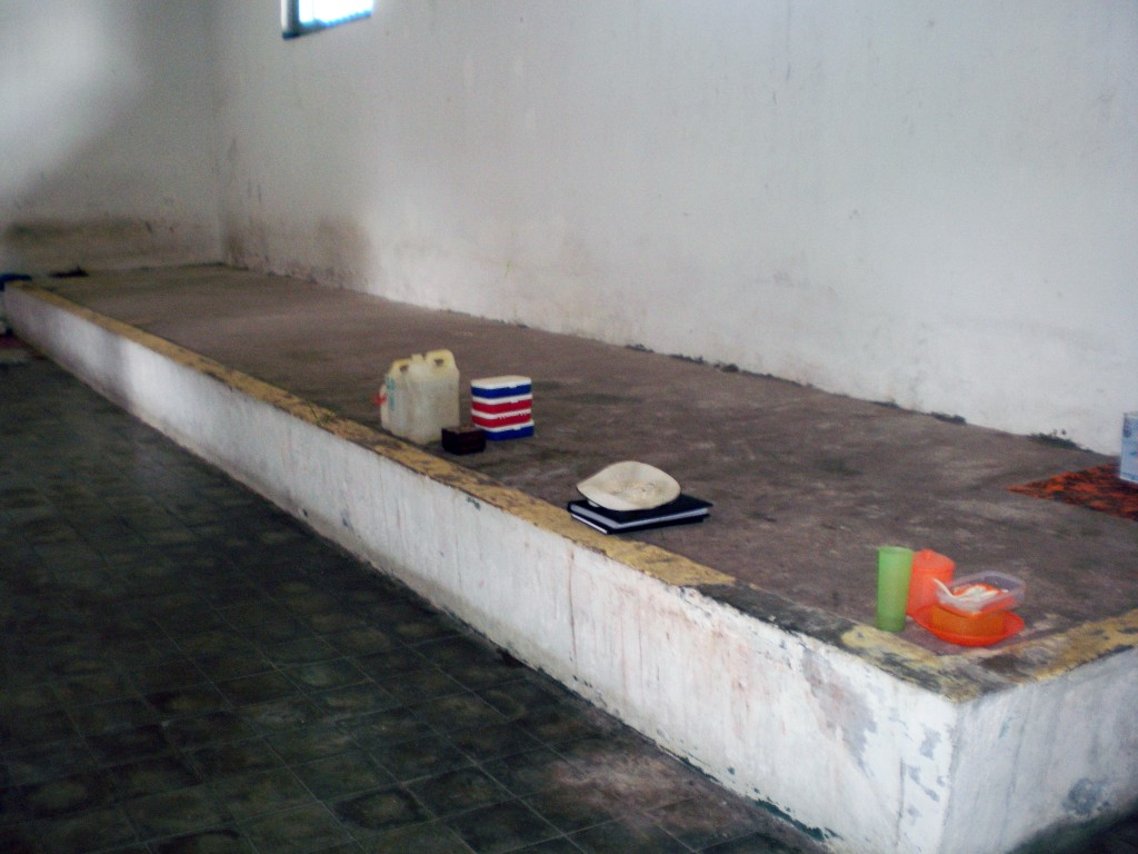 Concrete beds, Muntok Jail. Many men slept on this platform