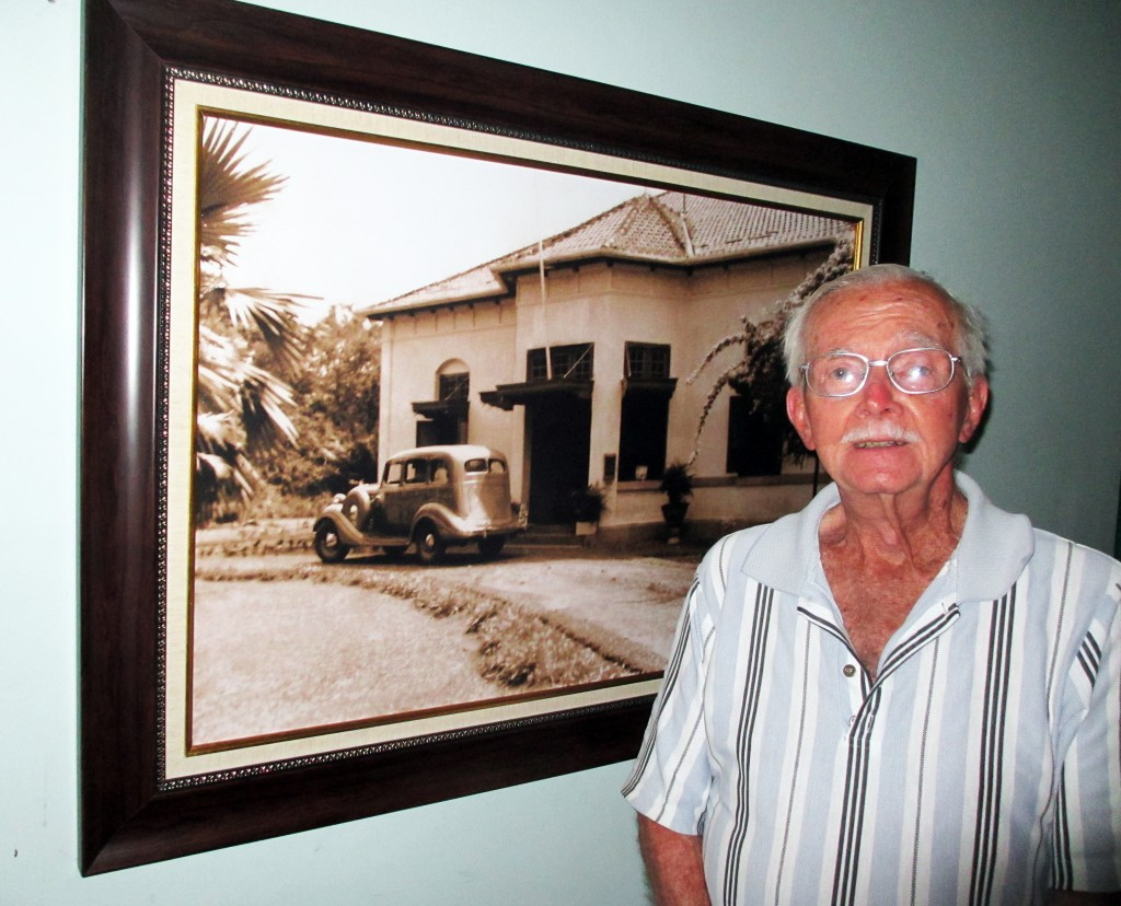 Neal Hobbs with photo of original Charitas Hospital for web