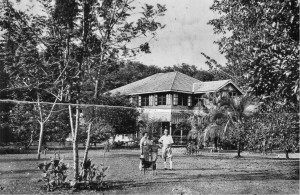 Colin Anne and John Campbell in fez, Sarasawatty Estate, between Bidor and Telok Anson, Perak, FMS